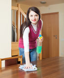Brunette woman cleaning wooden furiture Royalty Free Stock Photo