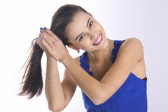 Brunette woman combing long hair Royalty Free Stock Photos
