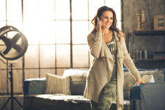 Brunette woman in comfortab in a loft living room Stock Image