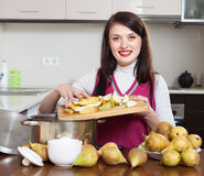 Brunette woman cooking pear jam Royalty Free Stock Photo