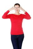 Brunette woman covering her face with both hands Royalty Free Stock Photography