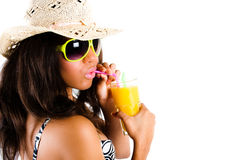 Brunette woman in cowboy hat, sunglasses, cocktail. Beautiful young brunette woman in cowboy hat and sunglasses enjoying a cocktail with puckered lips - isolated Royalty Free Stock Photography