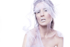 Brunette woman with creative make up in winter style with white Royalty Free Stock Image
