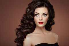 Brunette woman with curly hairstyle Royalty Free Stock Photo