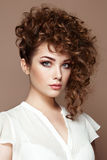Brunette woman with curly and shiny hair Stock Images