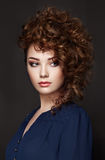 Brunette woman with curly and shiny hair stock photo
