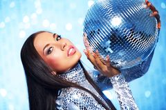 Brunette woman with a disco ball. Over abstract background royalty free stock image