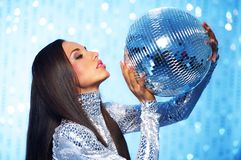 Brunette woman with a disco ball Stock Photography