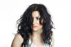 Brunette woman with disheveled hair Stock Images