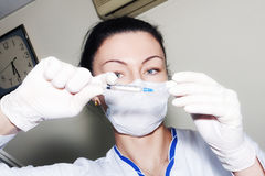 Brunette woman doctor preparing injection Royalty Free Stock Photo