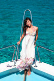 Woman standing on bow of yacht Royalty Free Stock Images