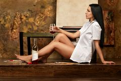 Brunette woman drinking red wine Royalty Free Stock Photo
