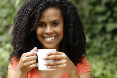 Brunette woman drinks coffee Stock Image