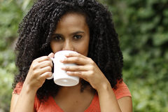 Brunette woman drinks coffee Royalty Free Stock Photos