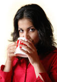 Brunette woman drinks from a mug. The beautiful brunette woman drinks from a mug Royalty Free Stock Photo