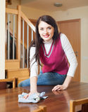 Brunette woman dusting  table Stock Images