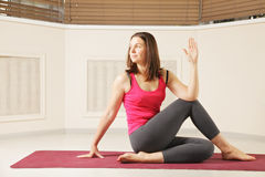 Brunette woman exercising yoga Stock Photo