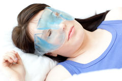 Brunette woman with an eye gel mask Royalty Free Stock Photo