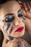 Brunette woman face with bright makeup with rhinestones closeup Stock Photo