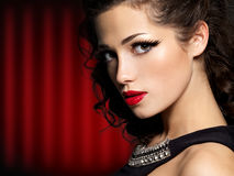 Brunette woman with fashion makeup and red lips Royalty Free Stock Photos