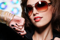 Brunette woman in fashion sunglasses stock photography