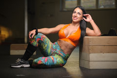 Brunette woman on the floor at the gym Stock Photography