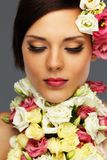 Brunette woman with flower collar Royalty Free Stock Photo