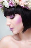 Brunette woman with flowers. Beautiful brunette woman with flowers on head royalty free stock photo
