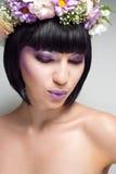 Brunette woman with flowers. Beautiful brunette woman with flowers on head stock image