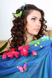 Brunette woman with flowers and butterflies Royalty Free Stock Image