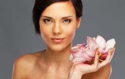 Brunette woman with flowers royalty free stock photo