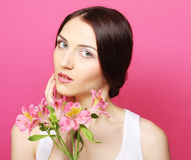 Brunette woman with flowers Stock Images