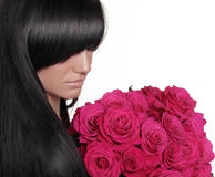 Brunette woman with fringe holding pink bouquet of roses isolate Royalty Free Stock Photo