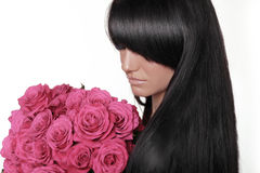 Brunette woman with fringe holding pink bouquet of roses isolate Royalty Free Stock Image