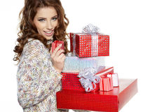 Brunette woman with a gift boxes Royalty Free Stock Images