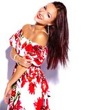 brunette woman girl going crazy in colorful bright summer red dress Stock Photos