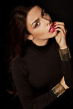 Brunette woman with glamour makeup and clothes Royalty Free Stock Photos