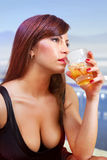 Brunette woman with glass of whisky Royalty Free Stock Photos