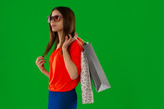 Brunette woman in glasses with shopping bag in hands Stock Images