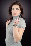 Brunette woman in gray dress Stock Photography