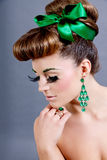 Brunette woman with green jewelery and accssesoires Stock Photos