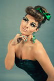 Brunette woman with green jewelery and accssesoires Royalty Free Stock Image