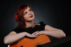 Brunette woman with guitar Stock Images