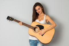 Brunette woman with guitar Royalty Free Stock Image