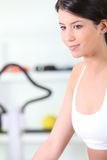 Brunette woman in the gym Stock Images