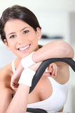 Brunette woman in the gym Royalty Free Stock Images