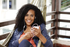 Brunette woman on hammock with cell phone Royalty Free Stock Photos