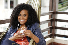 Brunette woman on hammock with cell phone Stock Photo