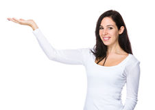 Brunette woman with hand showing somthing Stock Photography