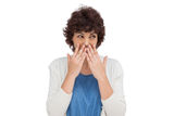 Brunette woman with hands on her mouth Stock Photo